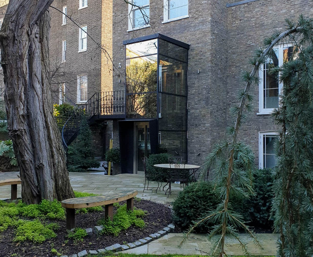 Outside lift for the home in a glass structure