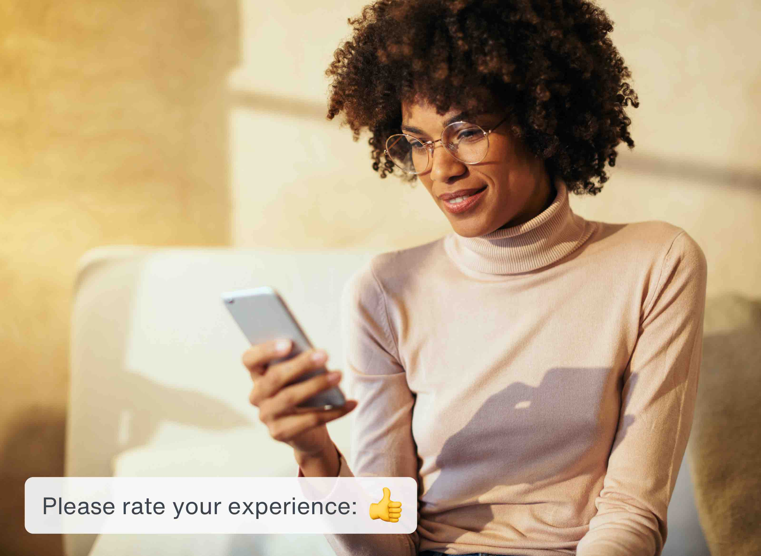 A woman relaxes with her phone and rates her experience with the app