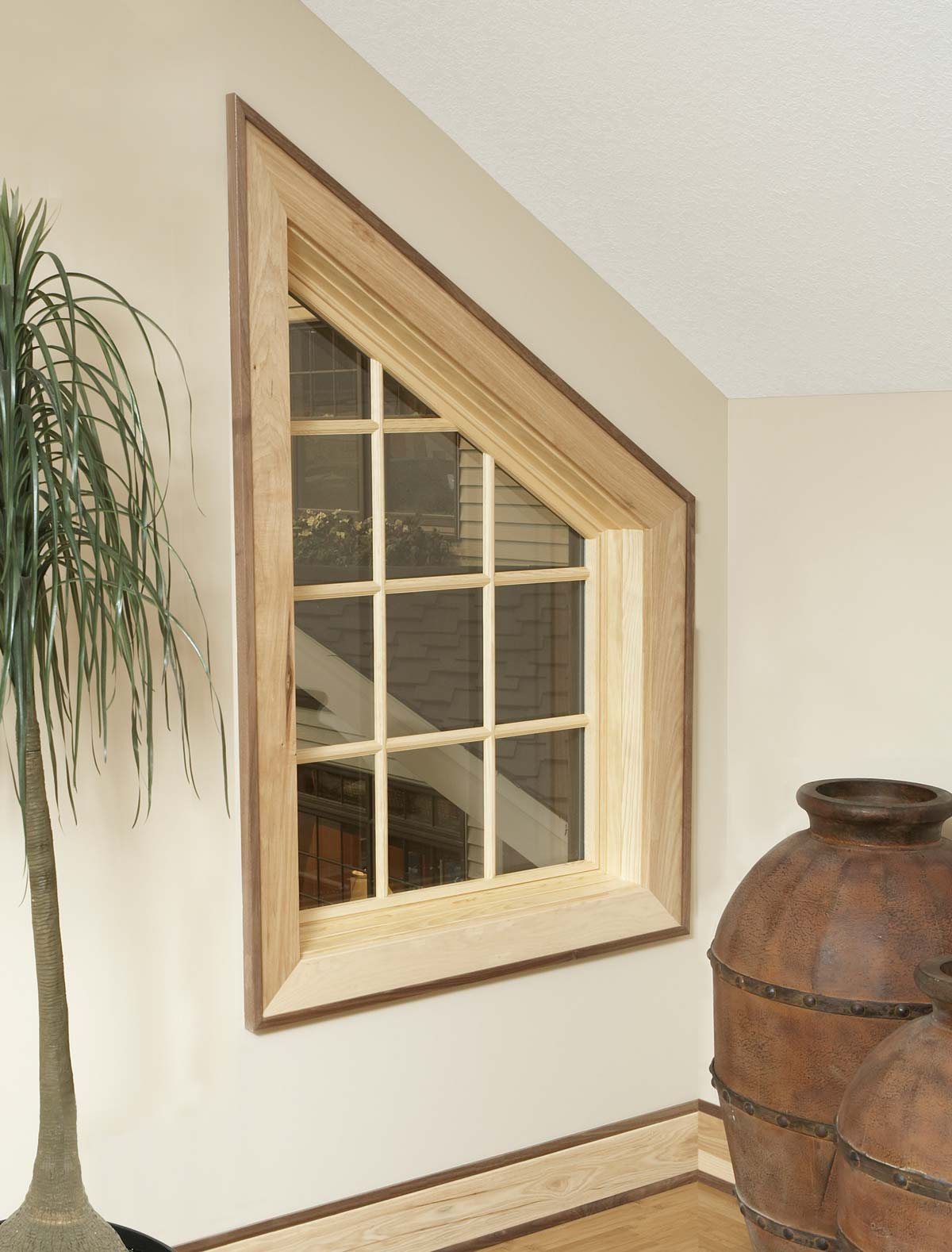 Whimsical triangular window with a sleek frame