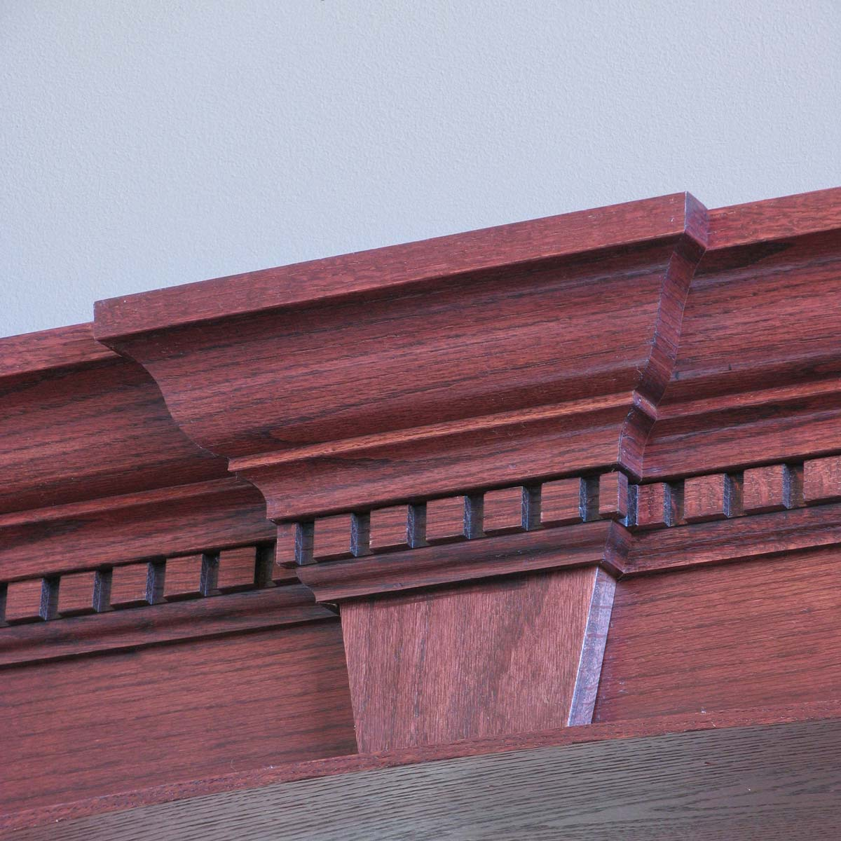 Cherry or walnut crown moulding with a decorative center jutting out