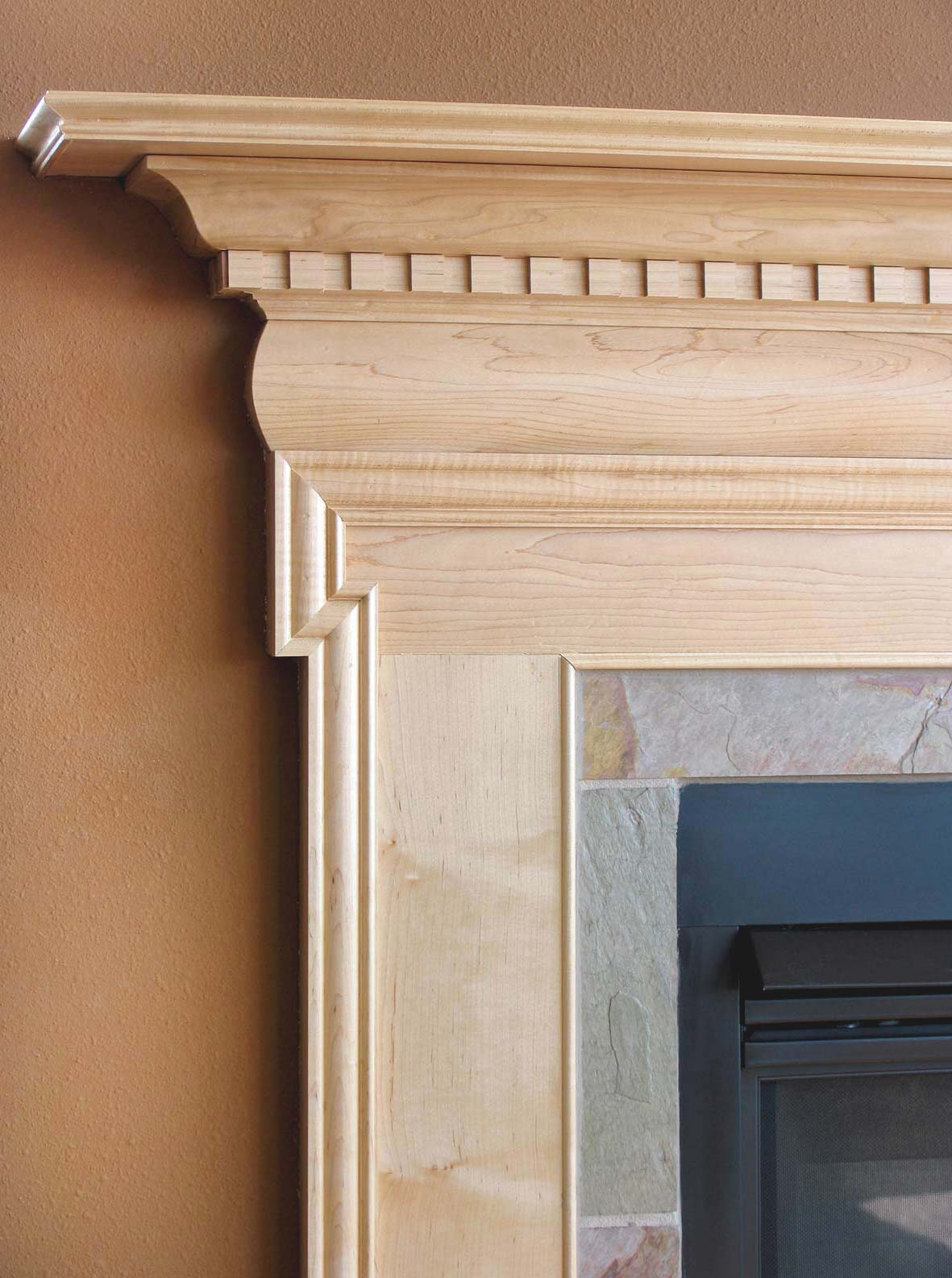 Hardwood mantel with an intricate repeating wood pattern