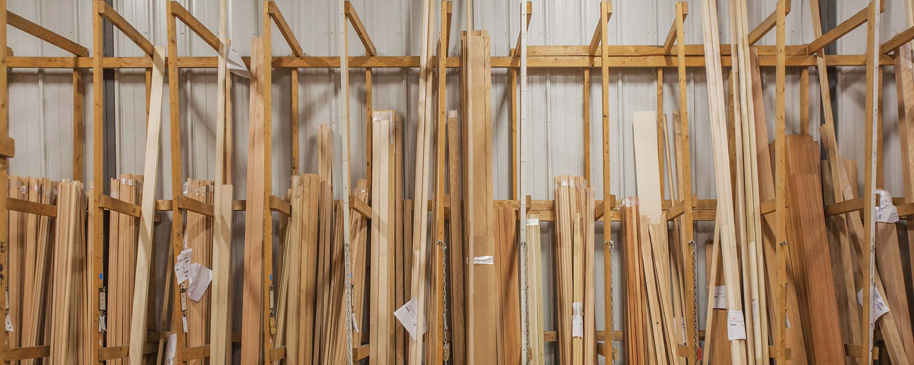 bins of long, untreated wood mouldings standing vertically