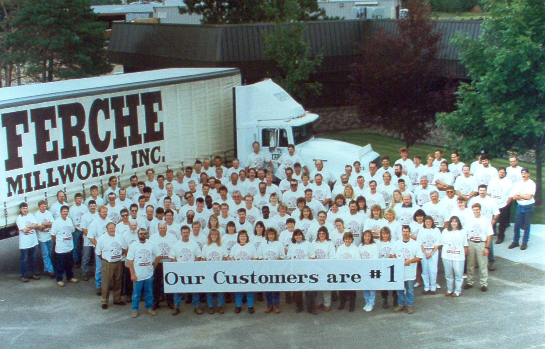 Historical group photo of the Ferche team, celebrating a company milestone