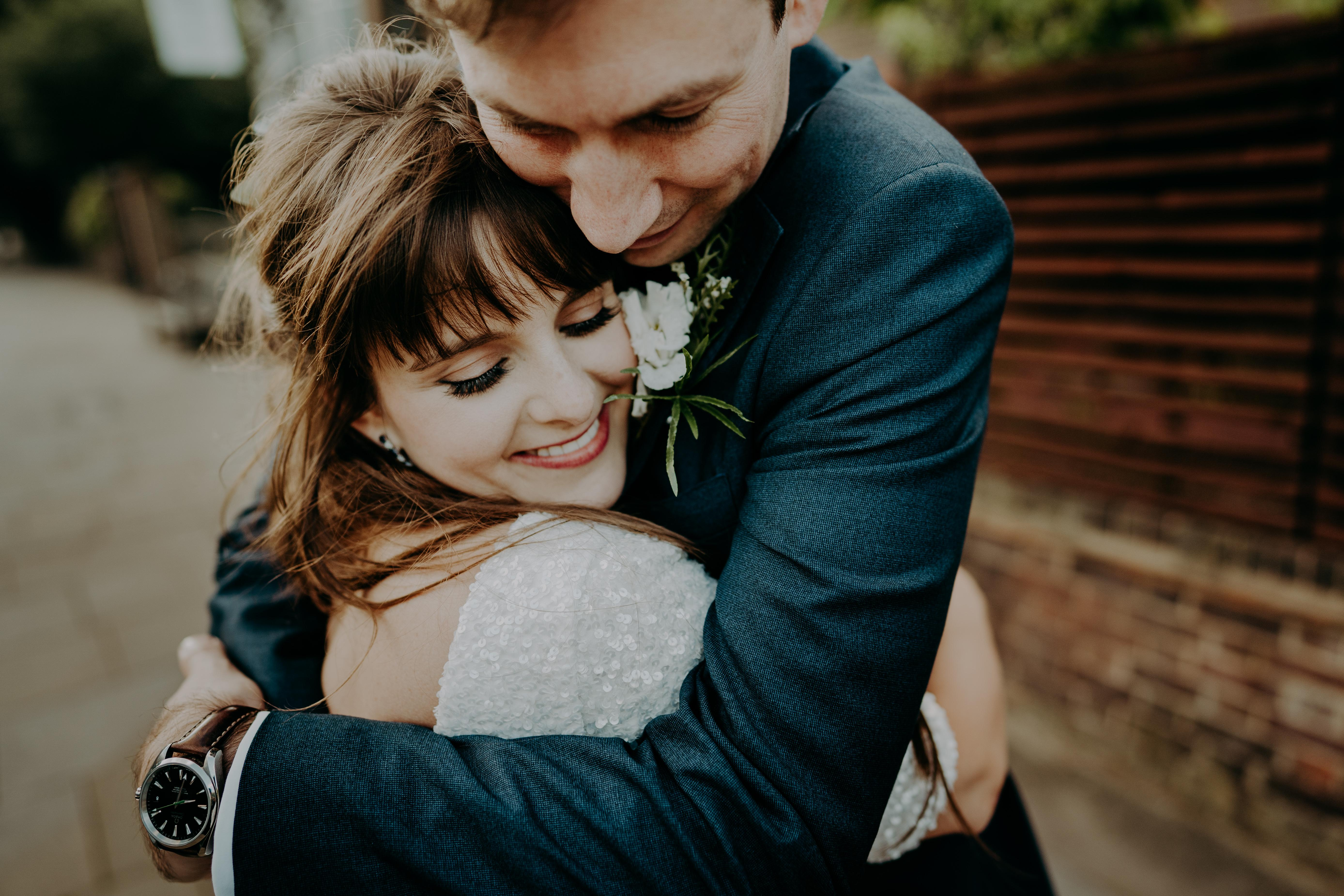 gorgeous-natural-bride-and-groom-hugging-in-love-london