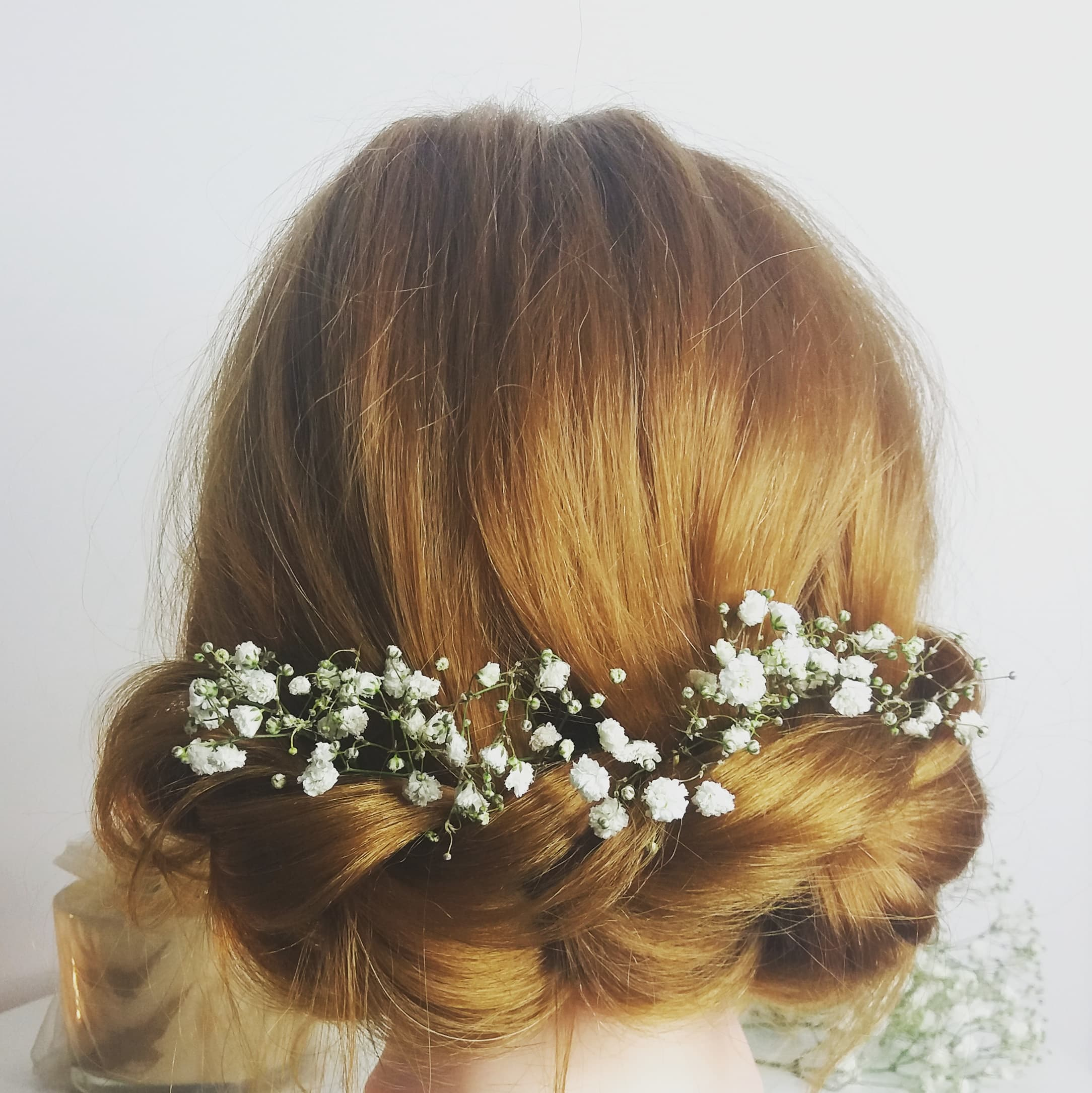 gorgeous-romantic-braided-up-do-with-flowers-London