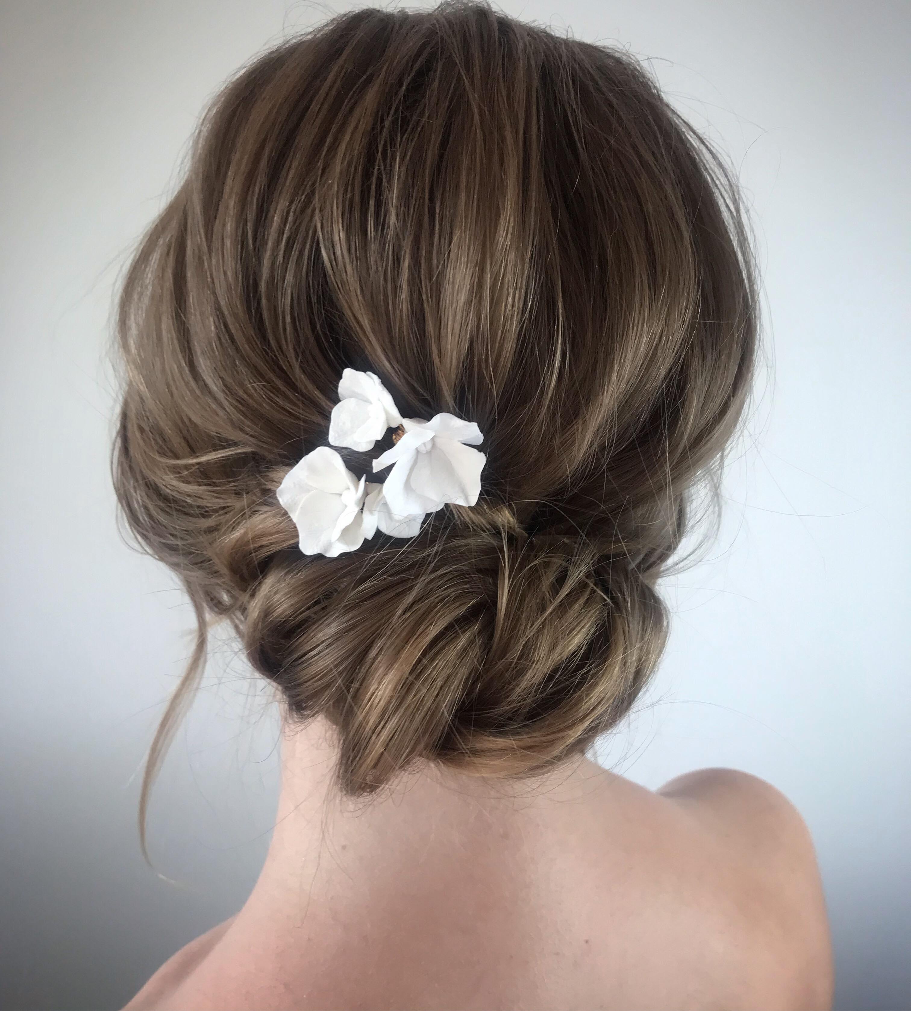 Beautiful-bridal-up-do-hair-bun-with-romantic-white-hair-pins-london