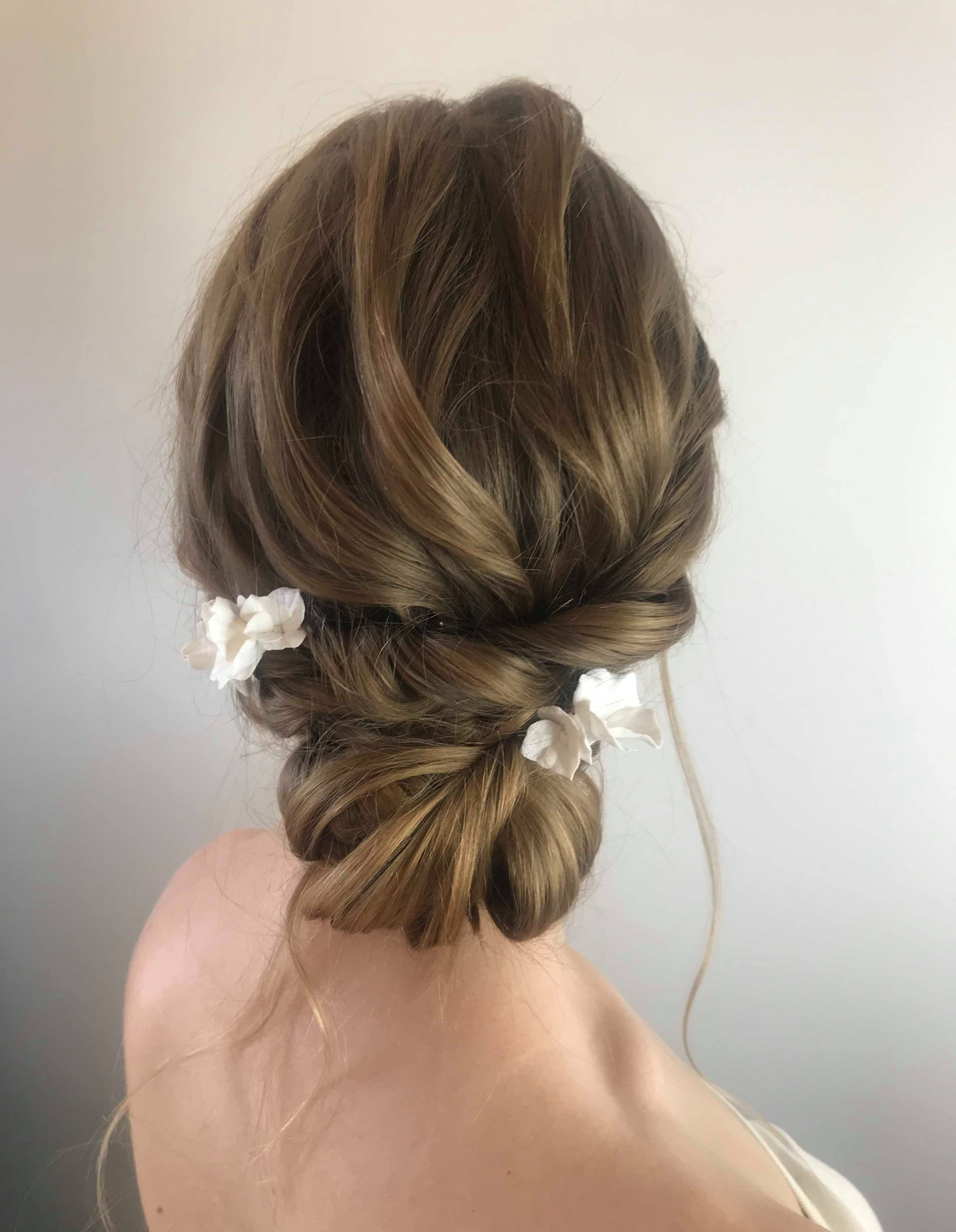 gorgeous--boho-bridal-updo-with-flower-hair-accessory-london