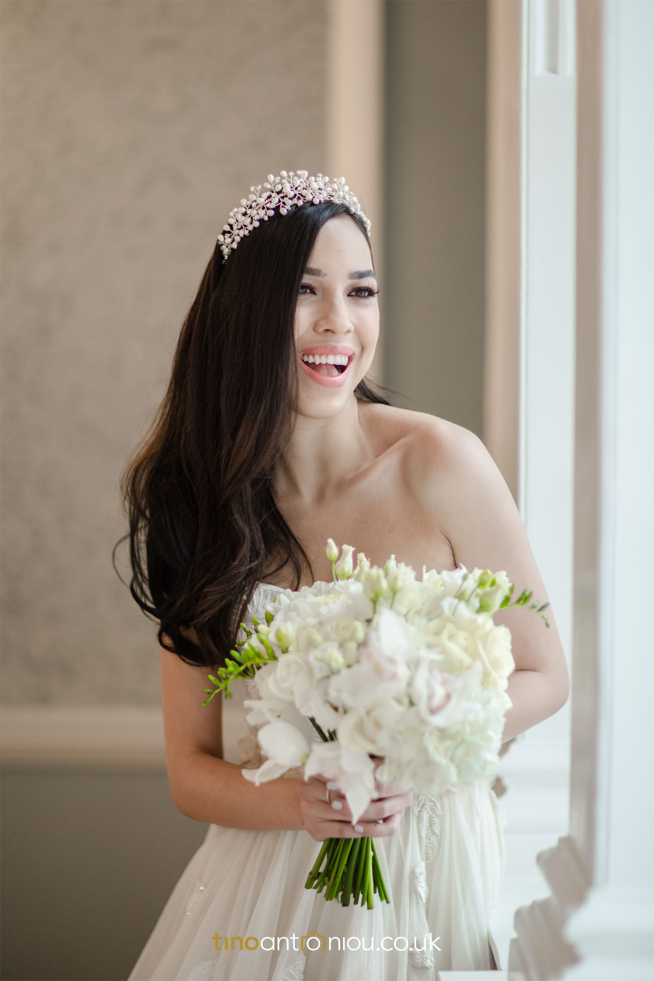 gorgeous-happy-modern-bride-standing-by-window-with-bouquet-south-London