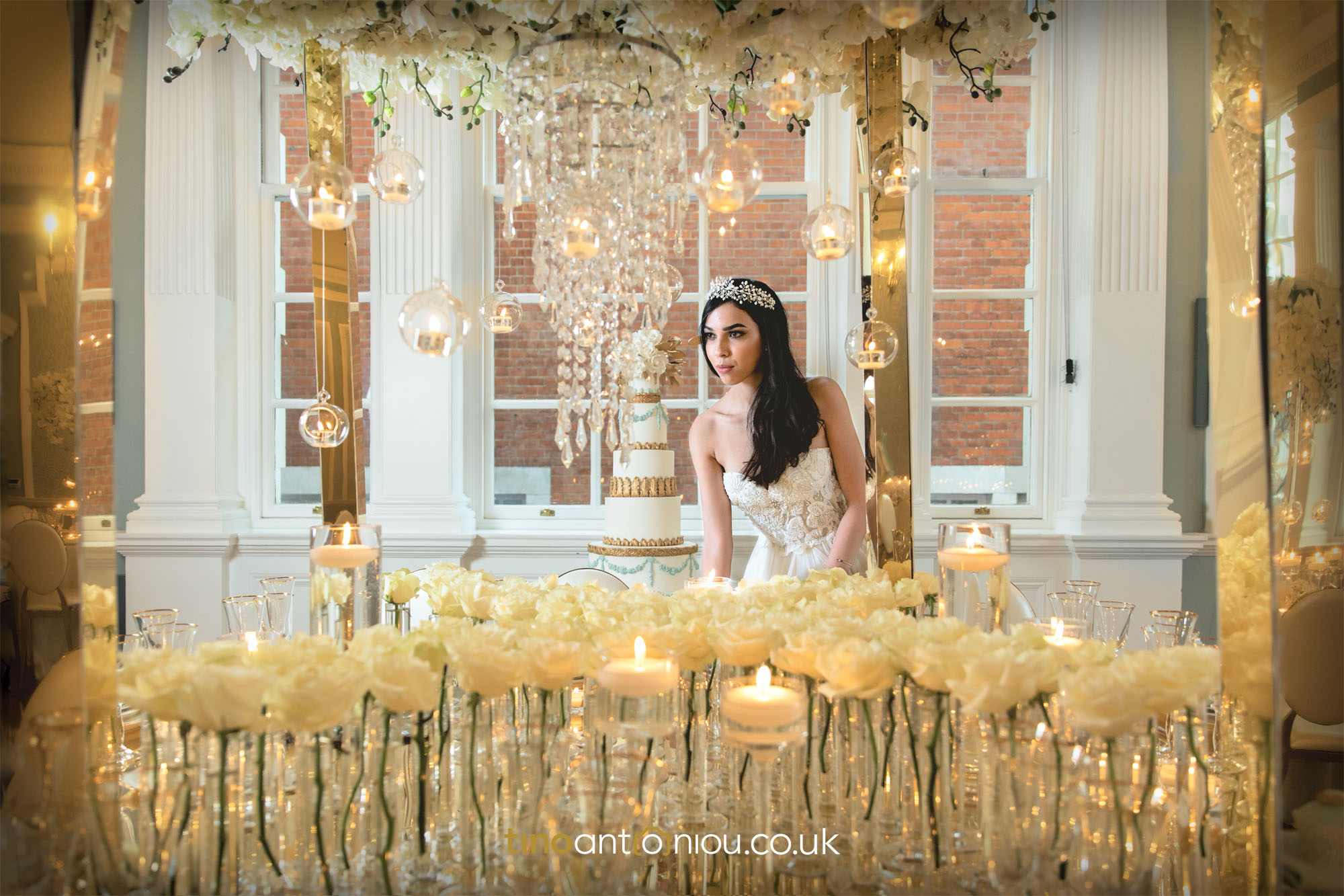 modern-bride-surrounded-by-candles-in-wedding-venue-Chelsea-London