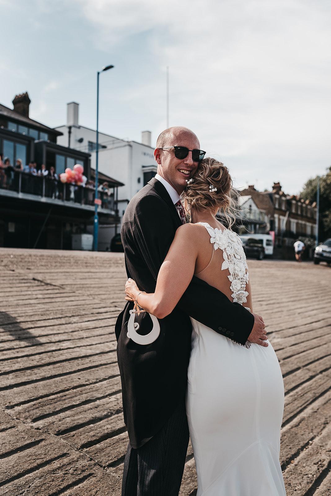 couple-embraced-on-wedding-day-london