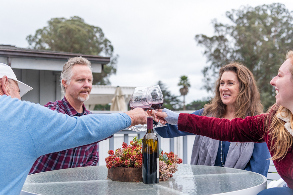 The Baker family enjoying some wine together