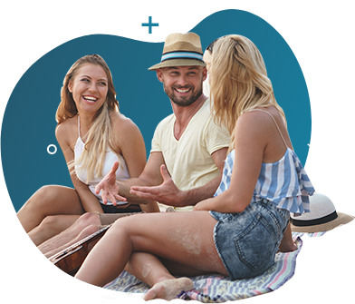 2 females and 1 male wearing a cowboy hat happily talking in the beach.