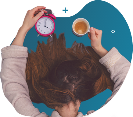a woman facing the table seemingly tired while holding a clock on her left hand and a mug half-filled with coffee
