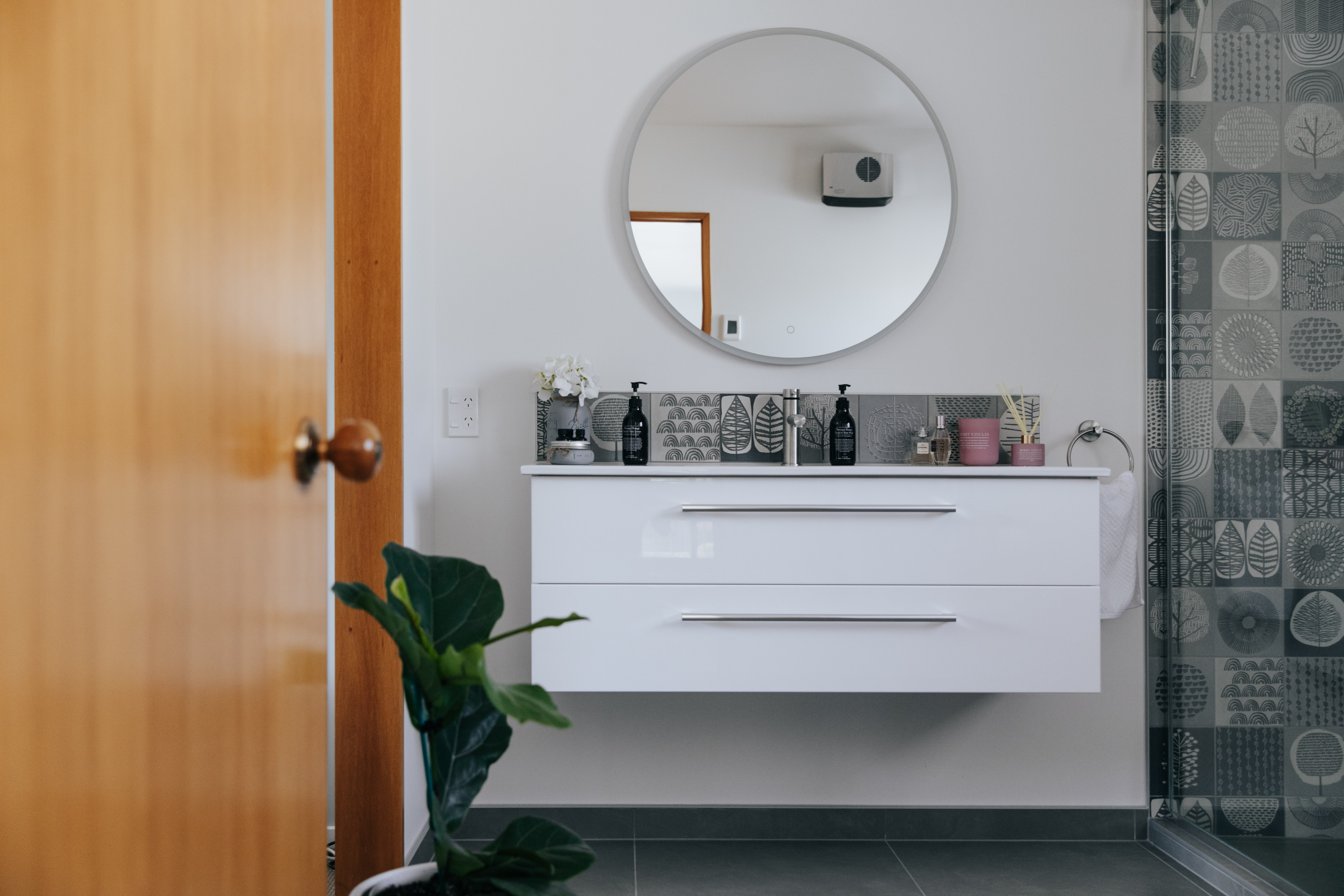 A 1200 wall hung vanity with a decorative tiled splashback