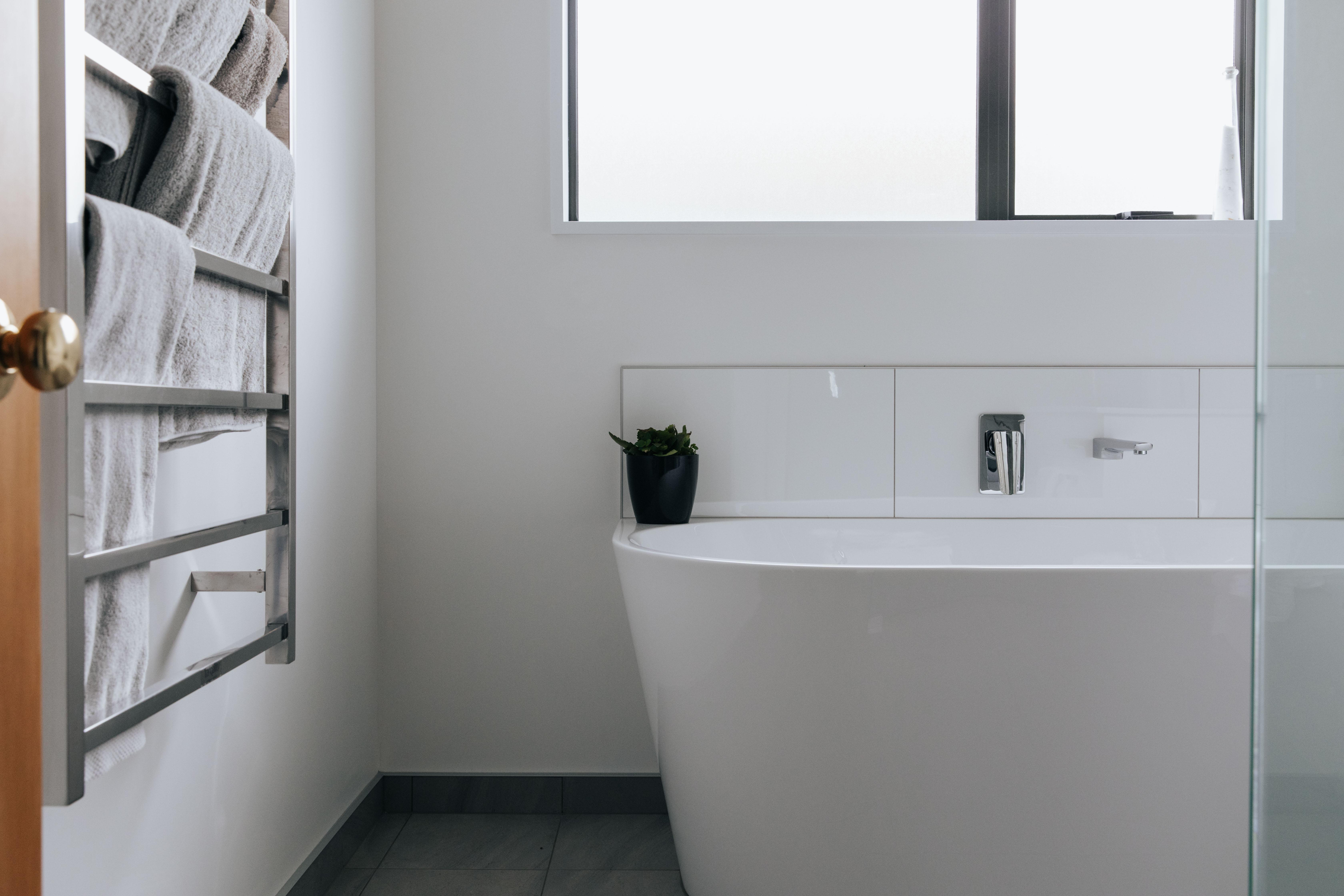 Tiled bathroom with freestanding bath