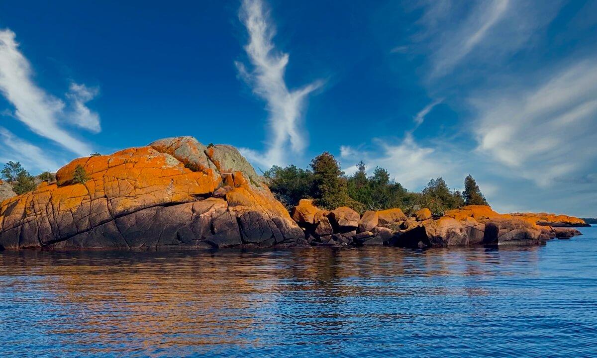 One of the Benjamin Islands featuring unique gorgeous orange rock.