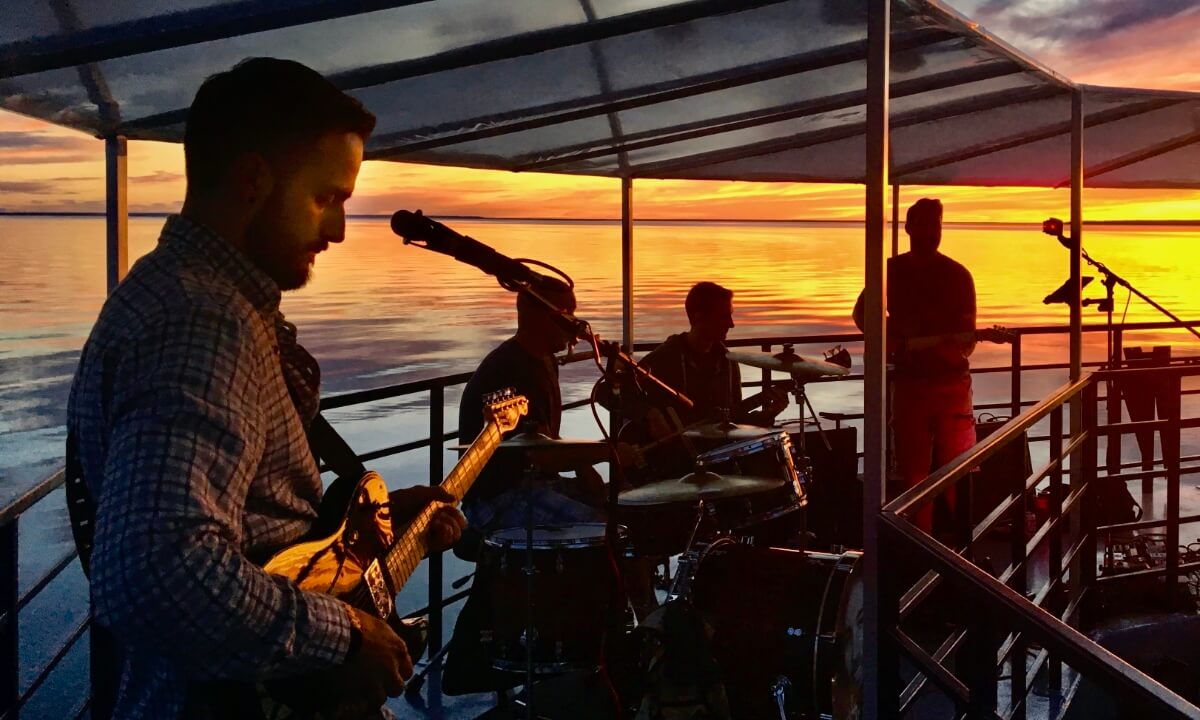 Band playing music on a Sunset Dinner Cruise off Manitoulin Island.