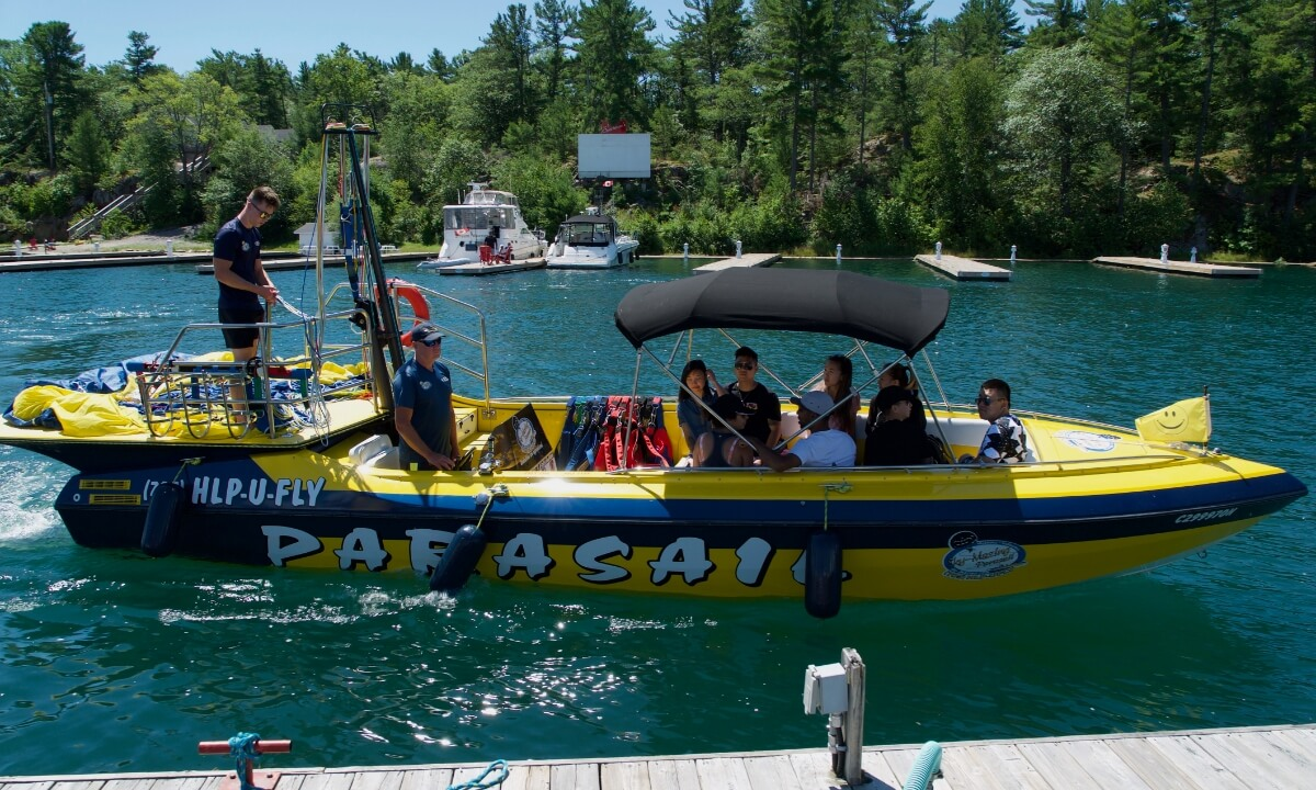 Boat with crew and passengers getting ready to head out and parasail.
