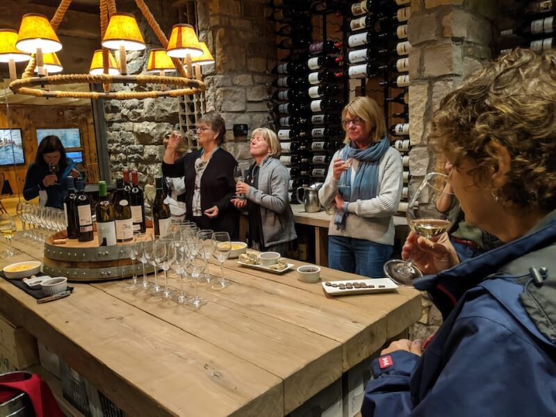 A group of women enjoying old and new wines as part of a wine tasting activity at Killarney Mountain Lodge.