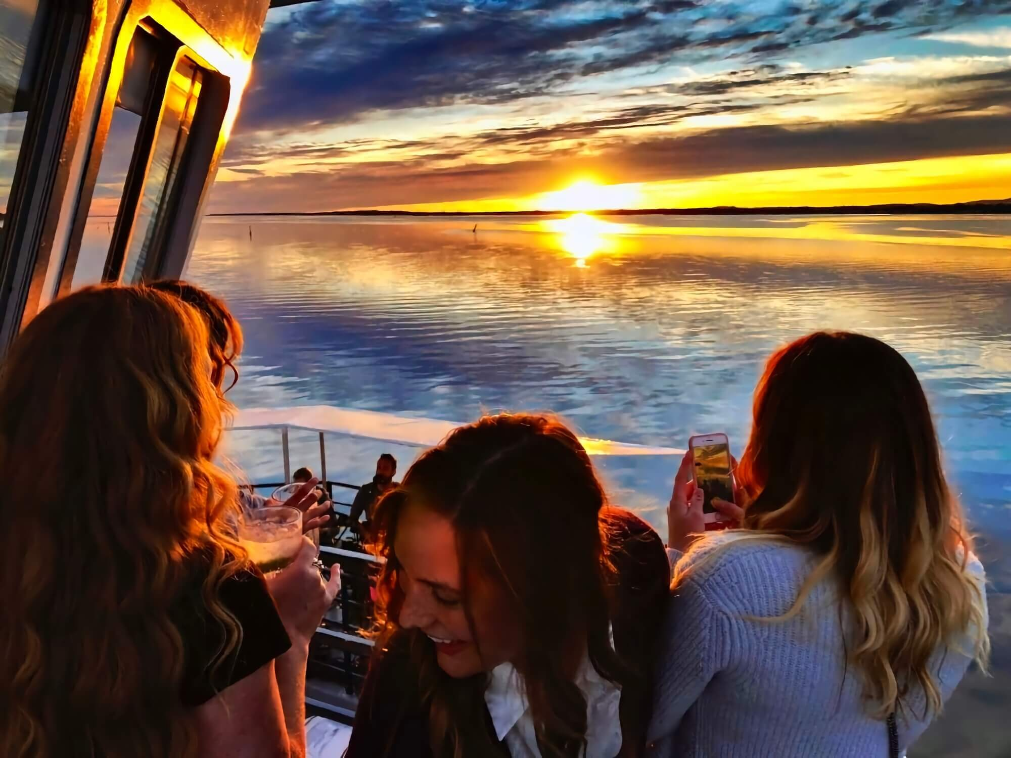 Passengers enjoying a beautiful sunset while on a boat cruise off the north shore of Manitoulin Island.