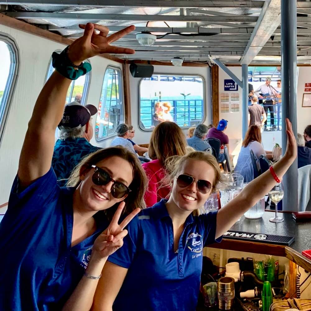 North Channel Cruise Line Staff waving hello at the beginning of a new tour.