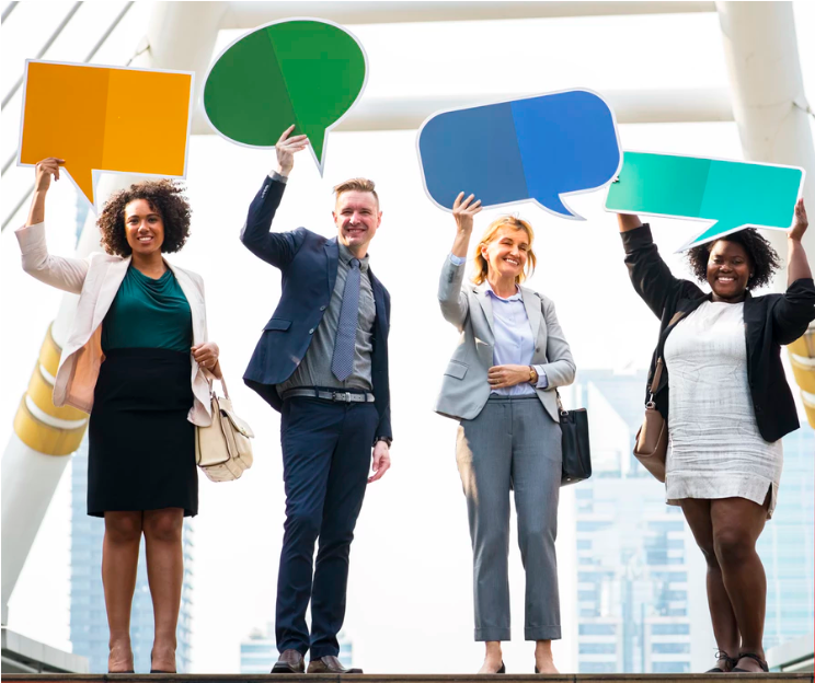 employees holding speech bubbles for empoyee feedback