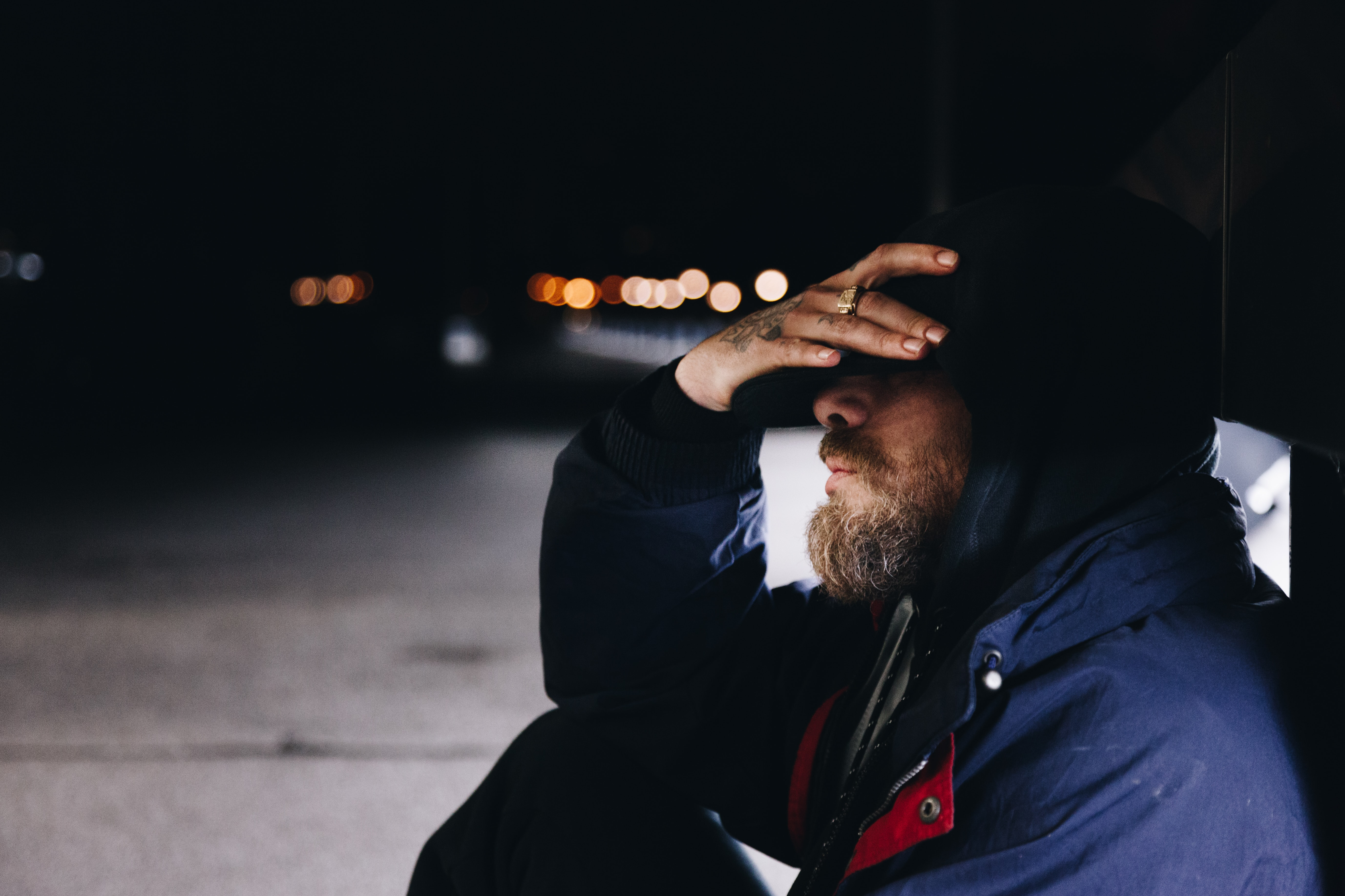 bearded man with hand on head feeling stuck in life