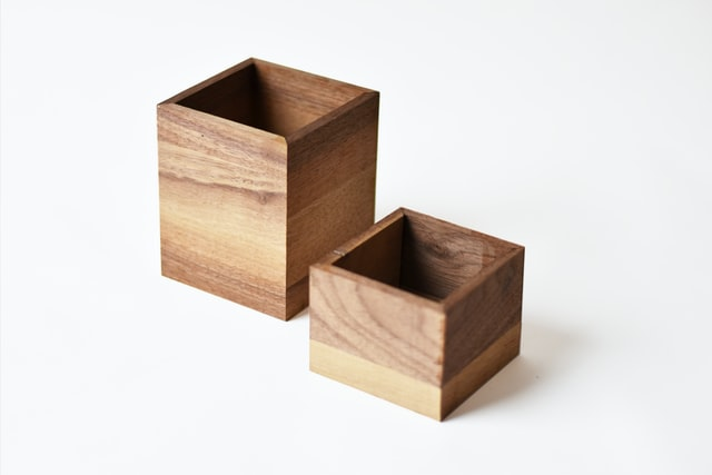 two wooden boxes next to each other
