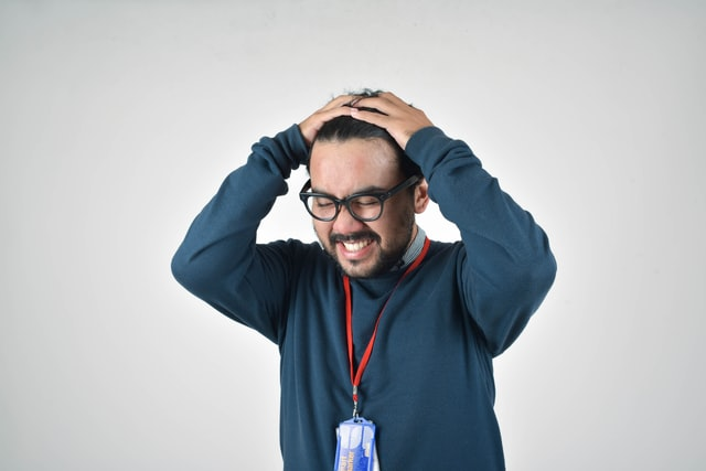frustrated man with hands on heads