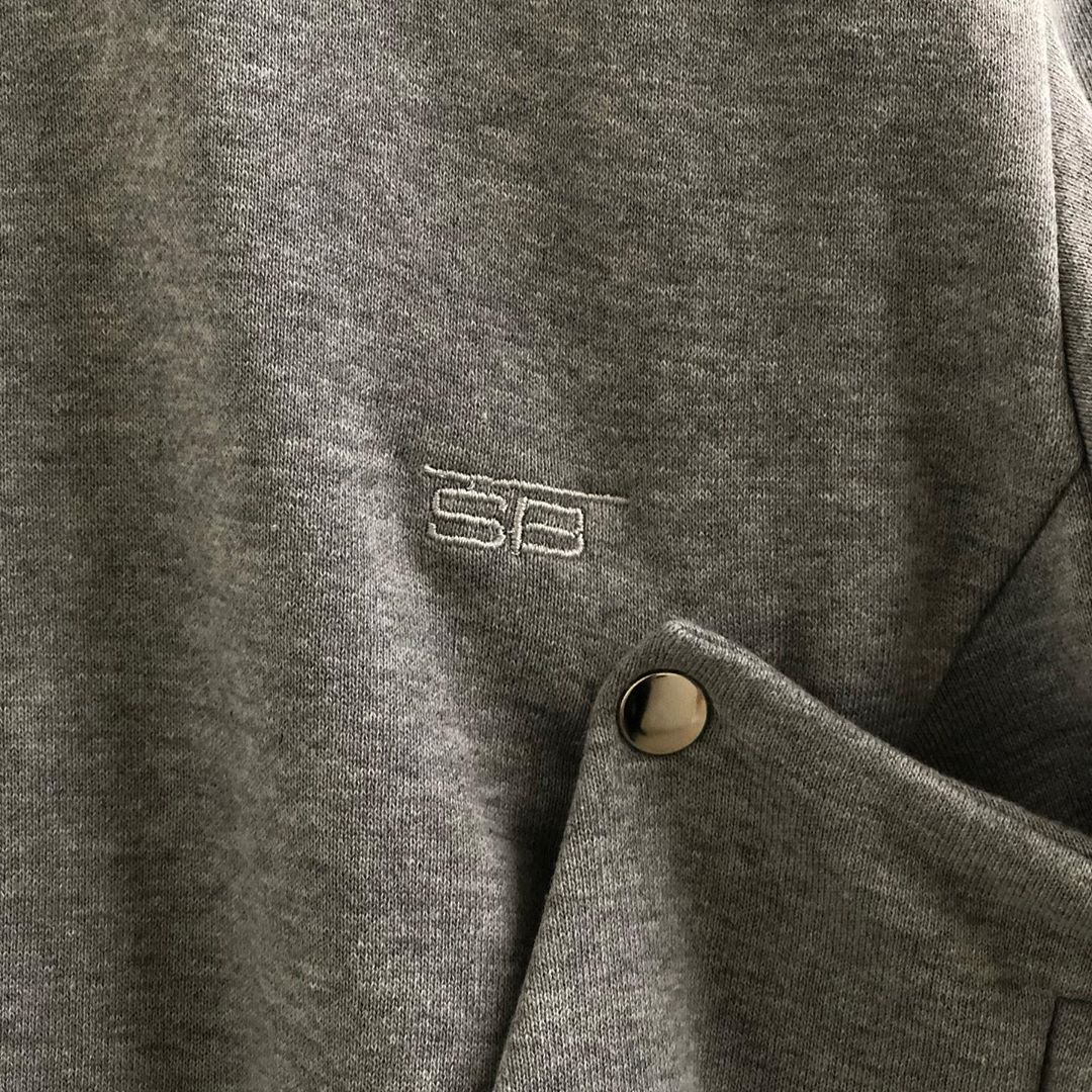 Branding on grey sweatshirt