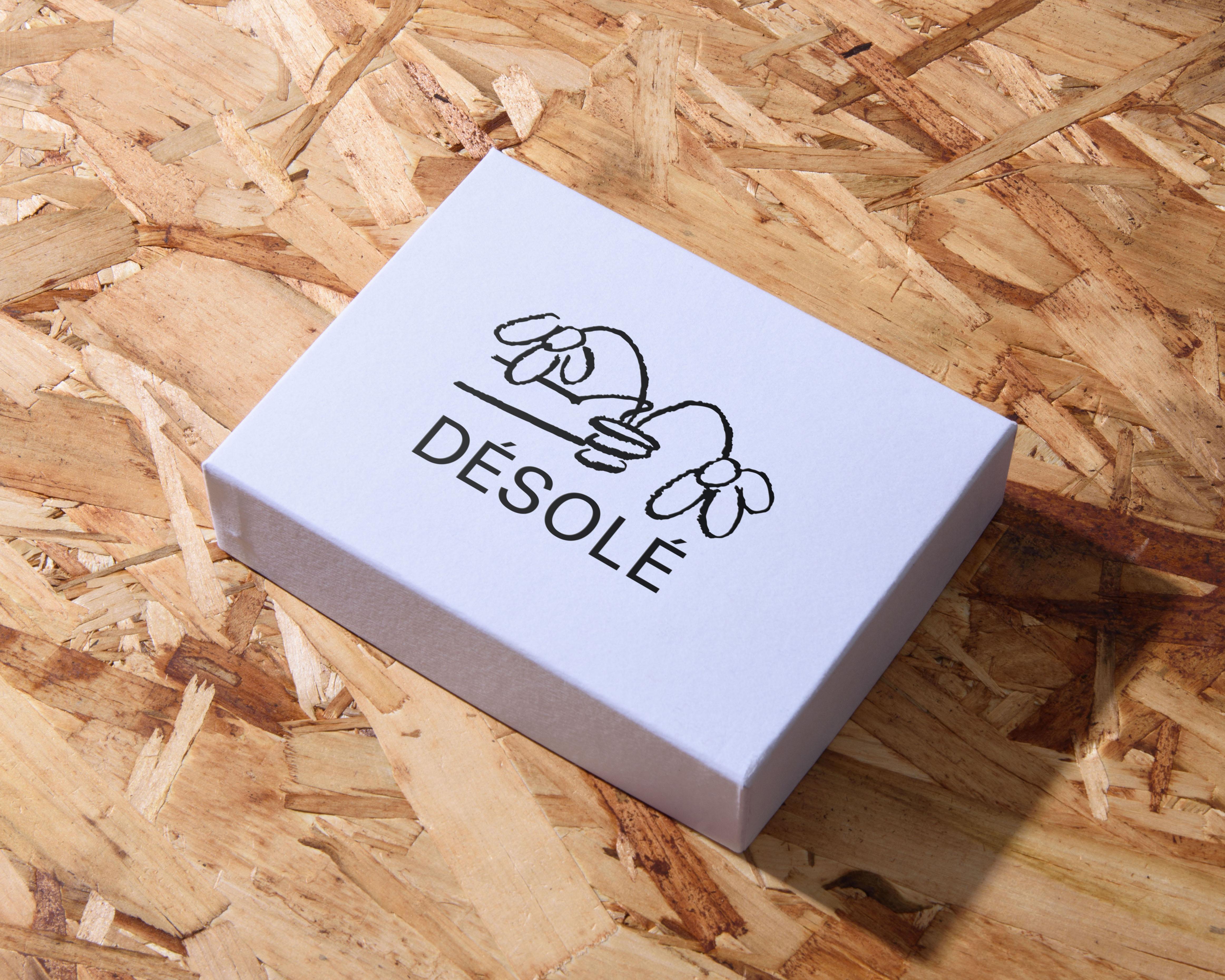 Désolé Branding Packaging on White Box