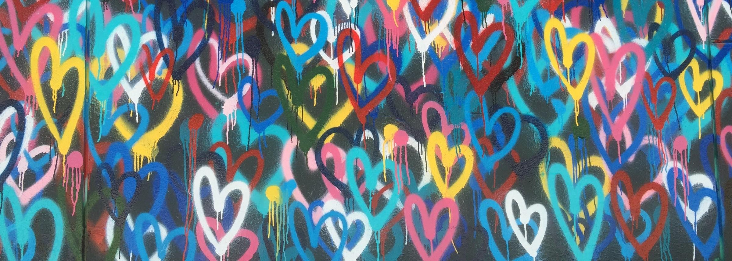 Graffiti wall full of hearts