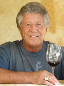 Mario Andretti with glass of wine