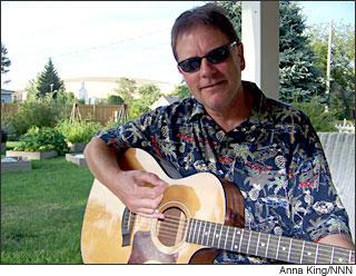 Paul Gregutt rocking the guitar