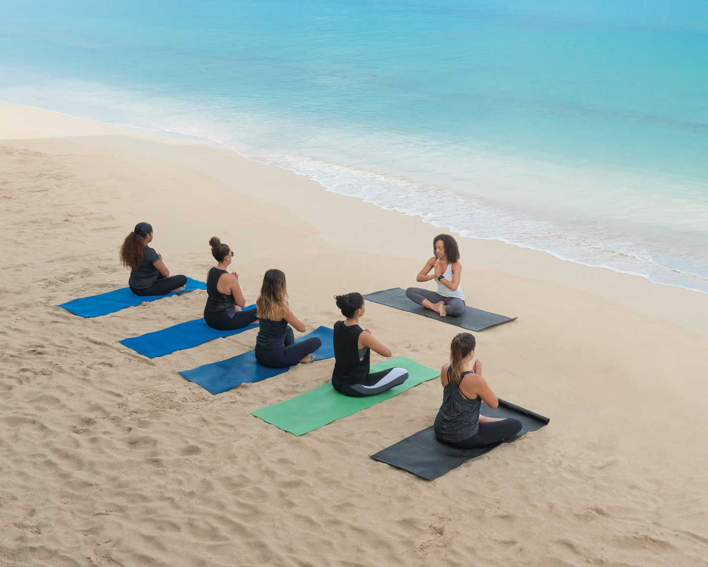 Yoga on the beach with Singita Wellness Centre