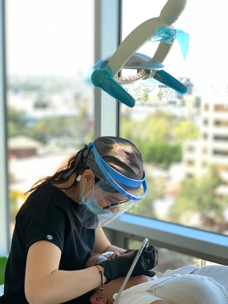 Dr. Silvia Guzman taking care of a patient. Cosmetic dentistry treatment in Tijuana