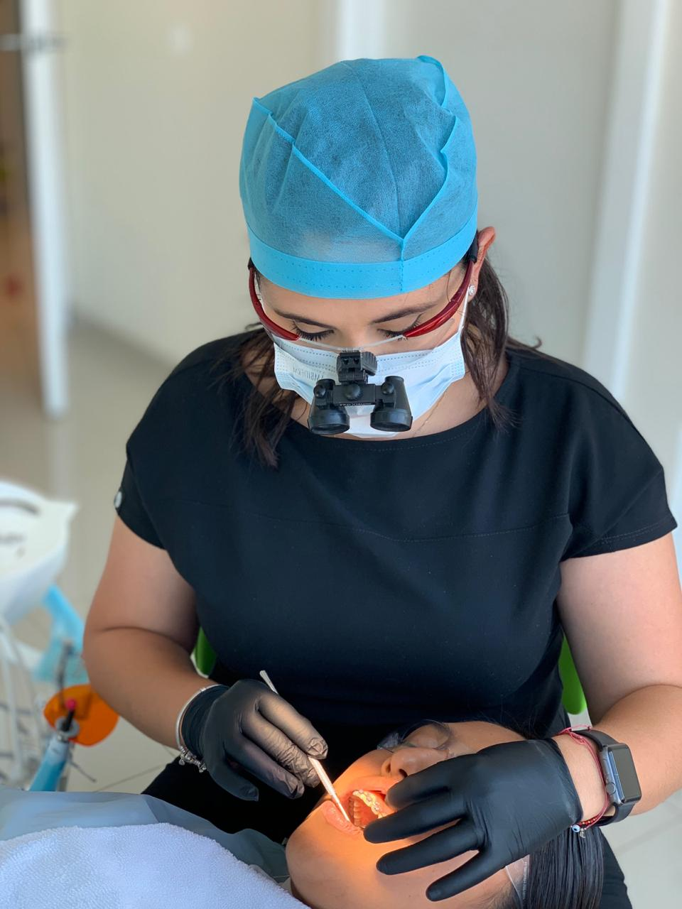 Dr. Lorena Izabal taking care of a patient. Root Canal treatment in Tijuana