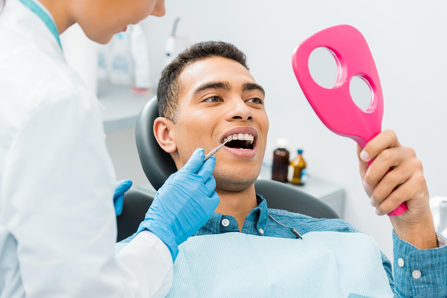 Man visiting the dentist for a dental bonding in Tijuana