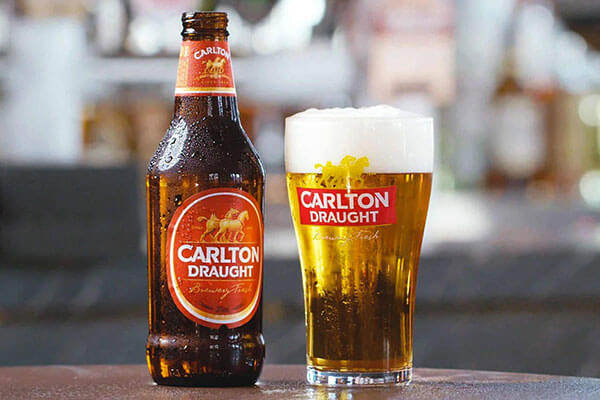 Carlton Draught promo image of beers at a bar