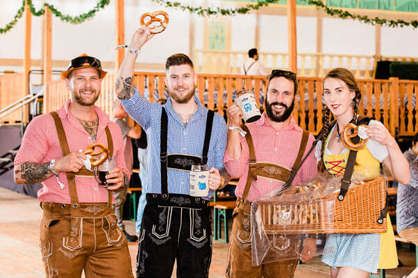 Photo from Oktoberfest of people dressed in German costumes