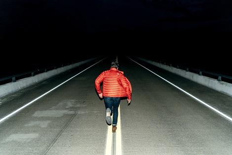 Running at night. Photo by Joshua Ness on Unsplash