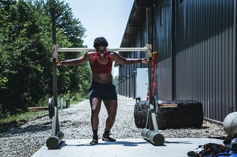 Lifting outside. Photo by Alora Griffiths on Unsplash