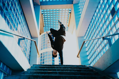 Man balancing. Photo by Daniel Schaffer on Unsplash