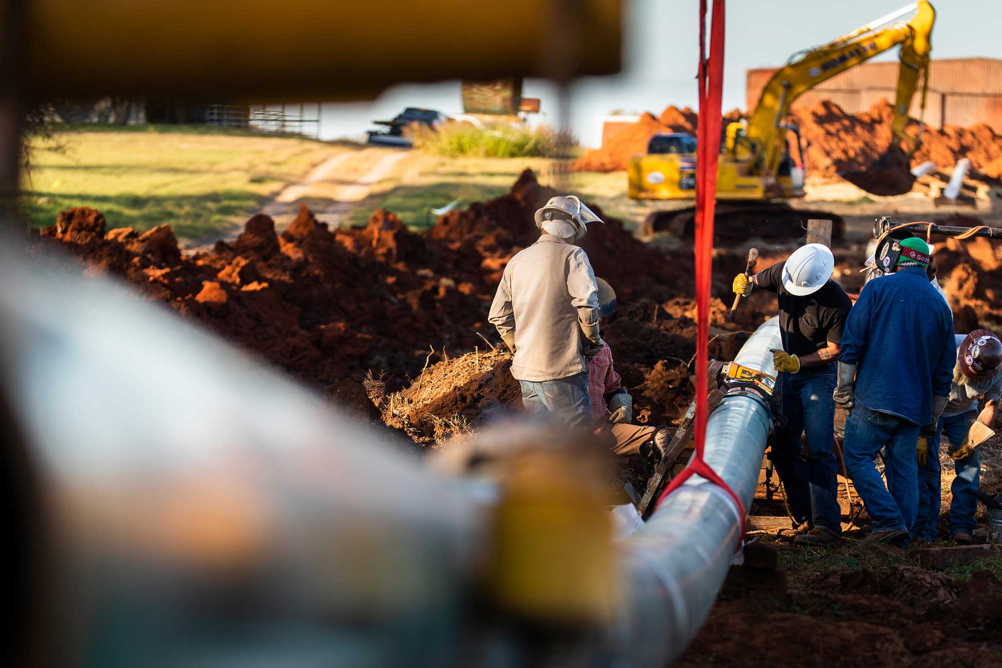 Workers repairing a pipeline from Tucker Services