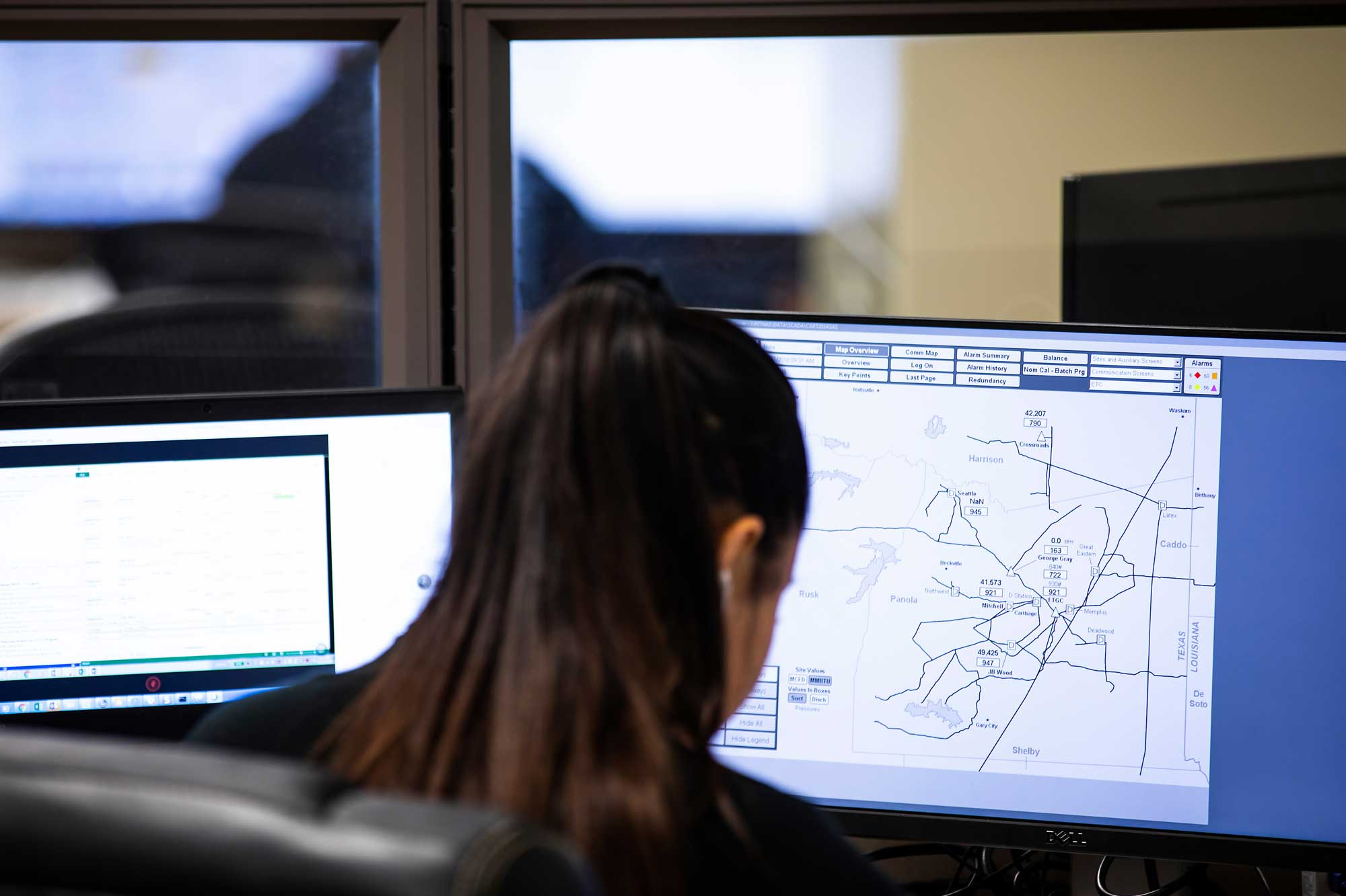 Woman working on computer at Nugen Automation