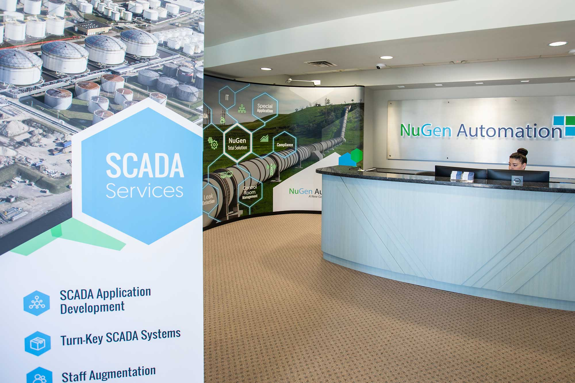 Reception area of Nugen Automation showing desk and pull up banner