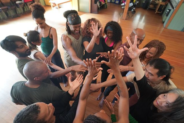 a movement liberation dance workshop for BIPOC with everyone bringing hands together