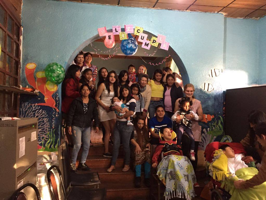group photo of children and care-givers at Casa Hogar in Ecuador