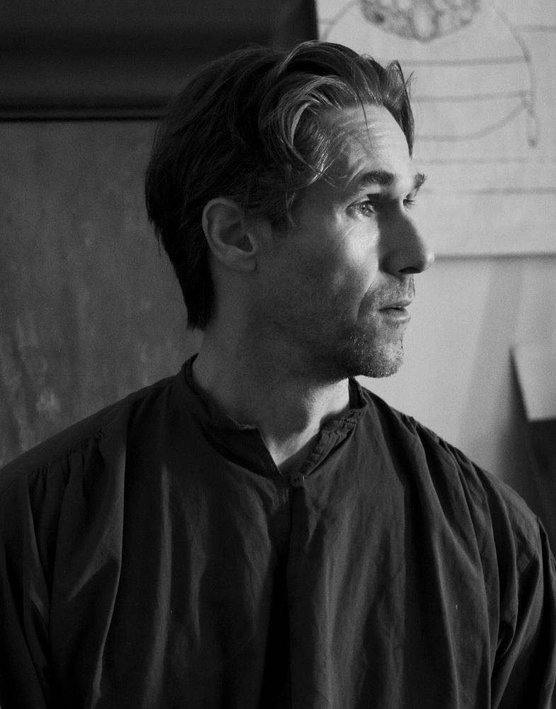 The artist Ross Kolby smiling - black white photo