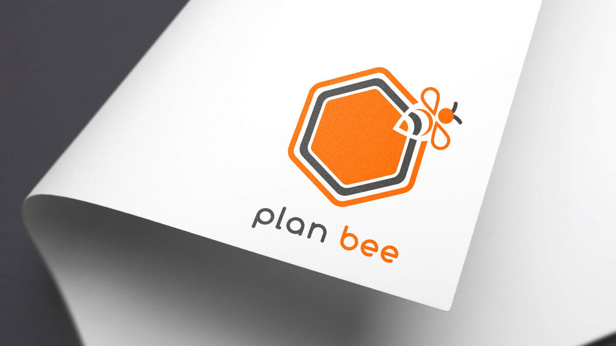 a hexagon with a bee logo